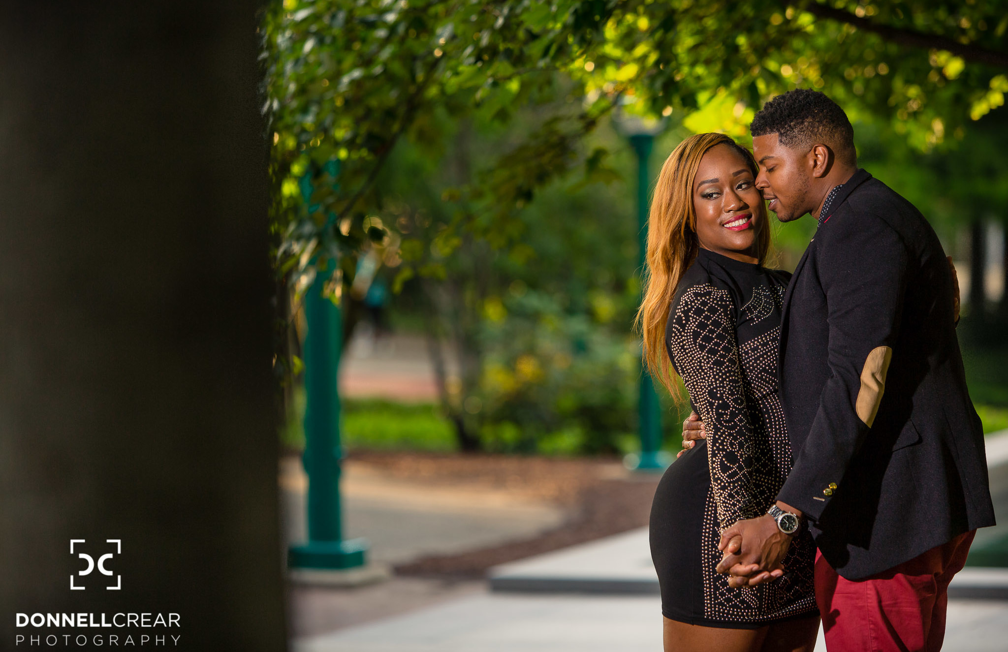Engaged couple embracing during their Centennial Olympic Park engagement session