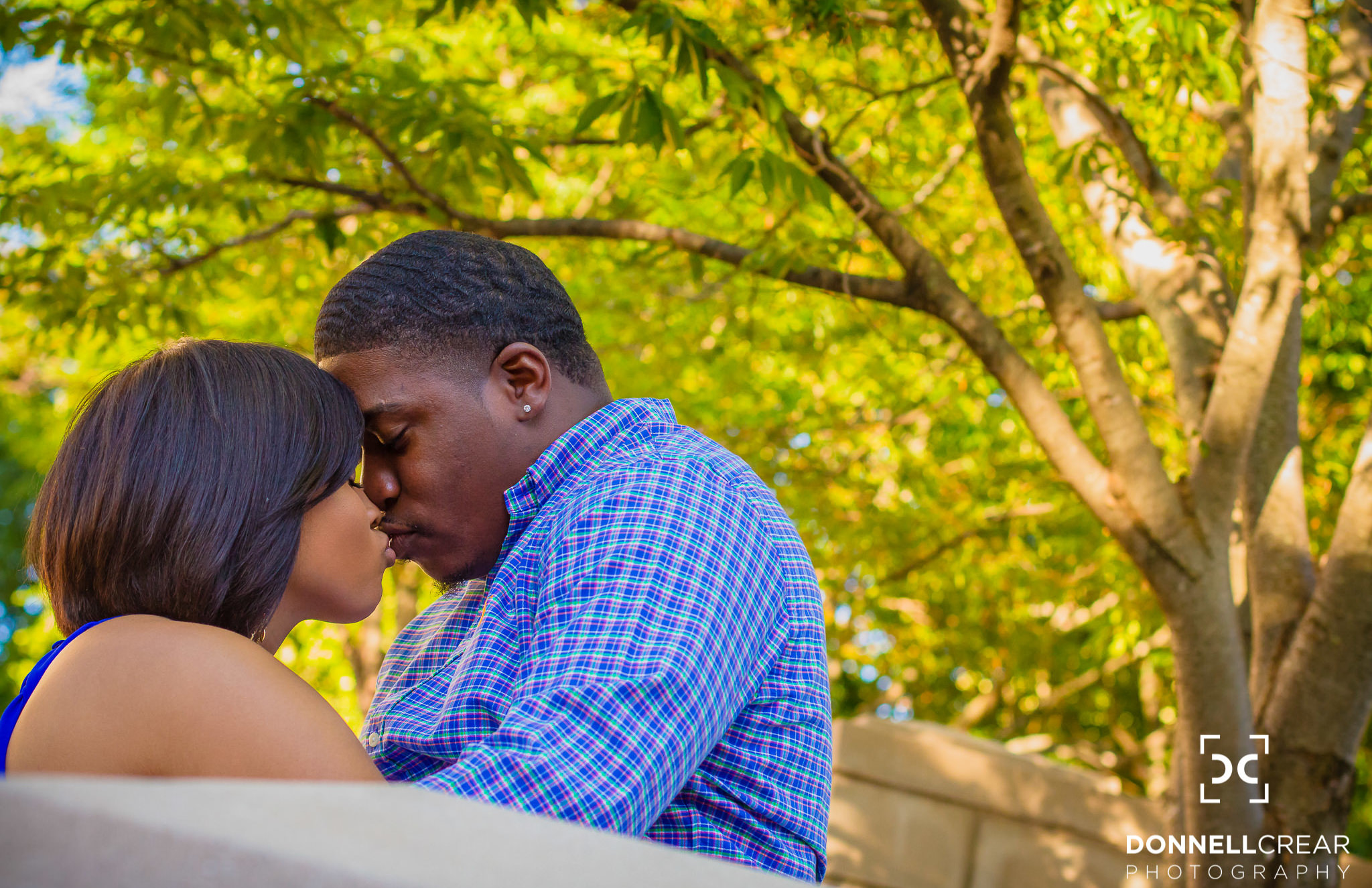African American engaged couple embracing during their Downtown Spartanburg engagement session