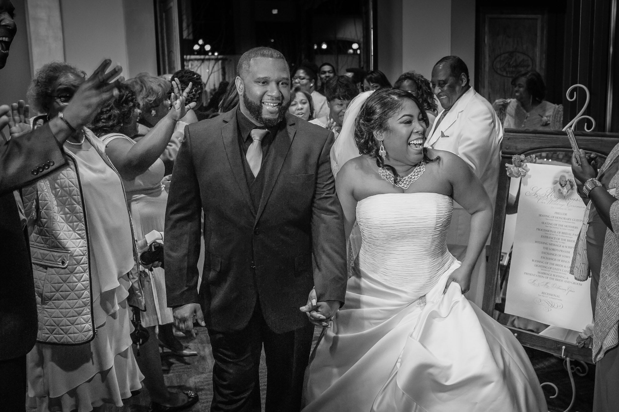 One of the best wedding photographers in Greenville SC photo of an African American couple exiting their wedding reception