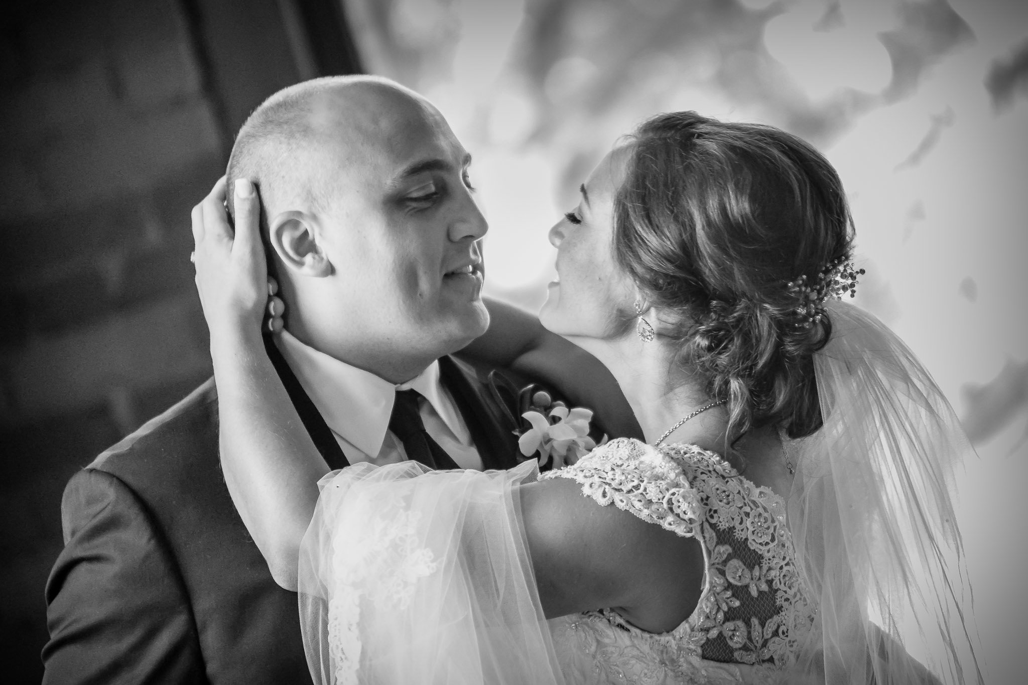 One of the best wedding photographers in Greenville SC photo of bride embracing groom during reception