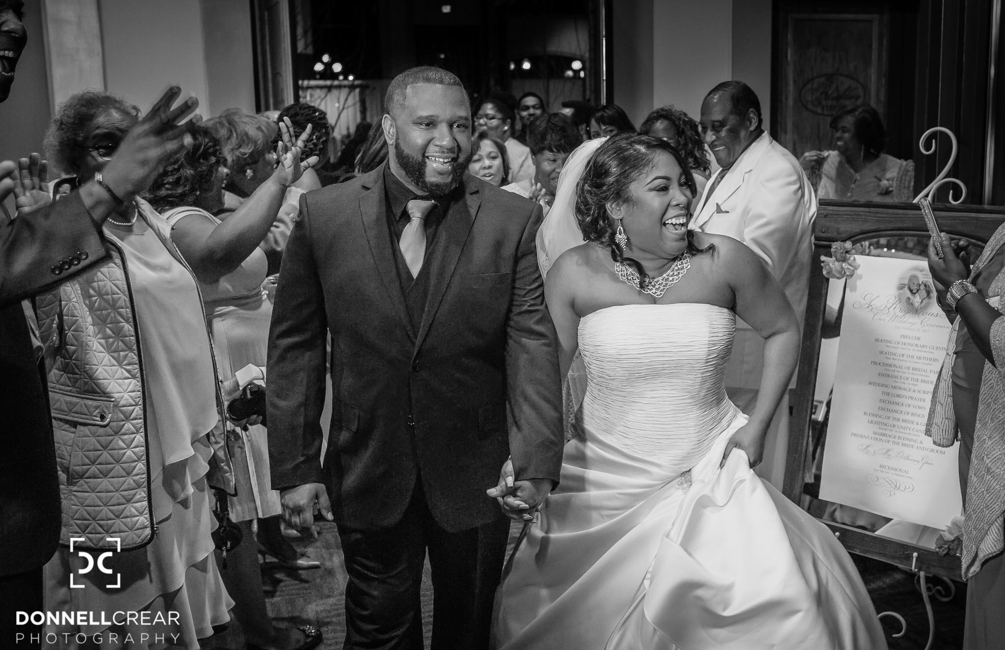 African American couple holding hands during Bleckley Station wedding exit