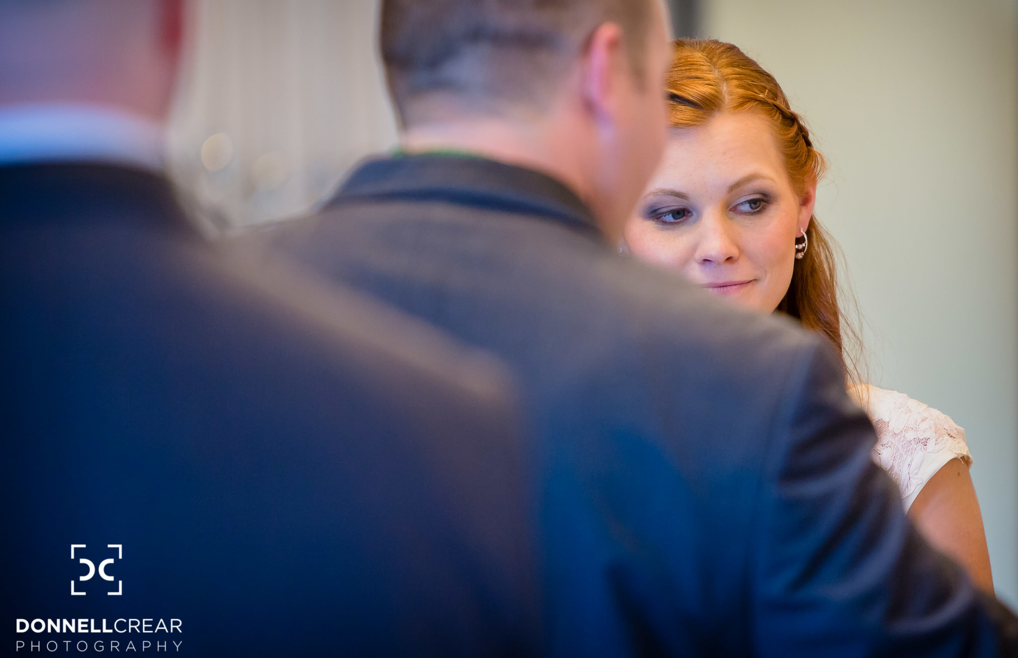 Bride looking at the officiant during her Events at Sapphire Creek wedding