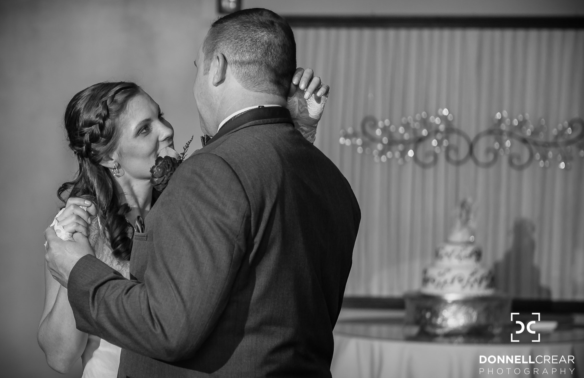 Bride and groom sharing their first dance during the reception of their Events at Sapphire Creek wedding