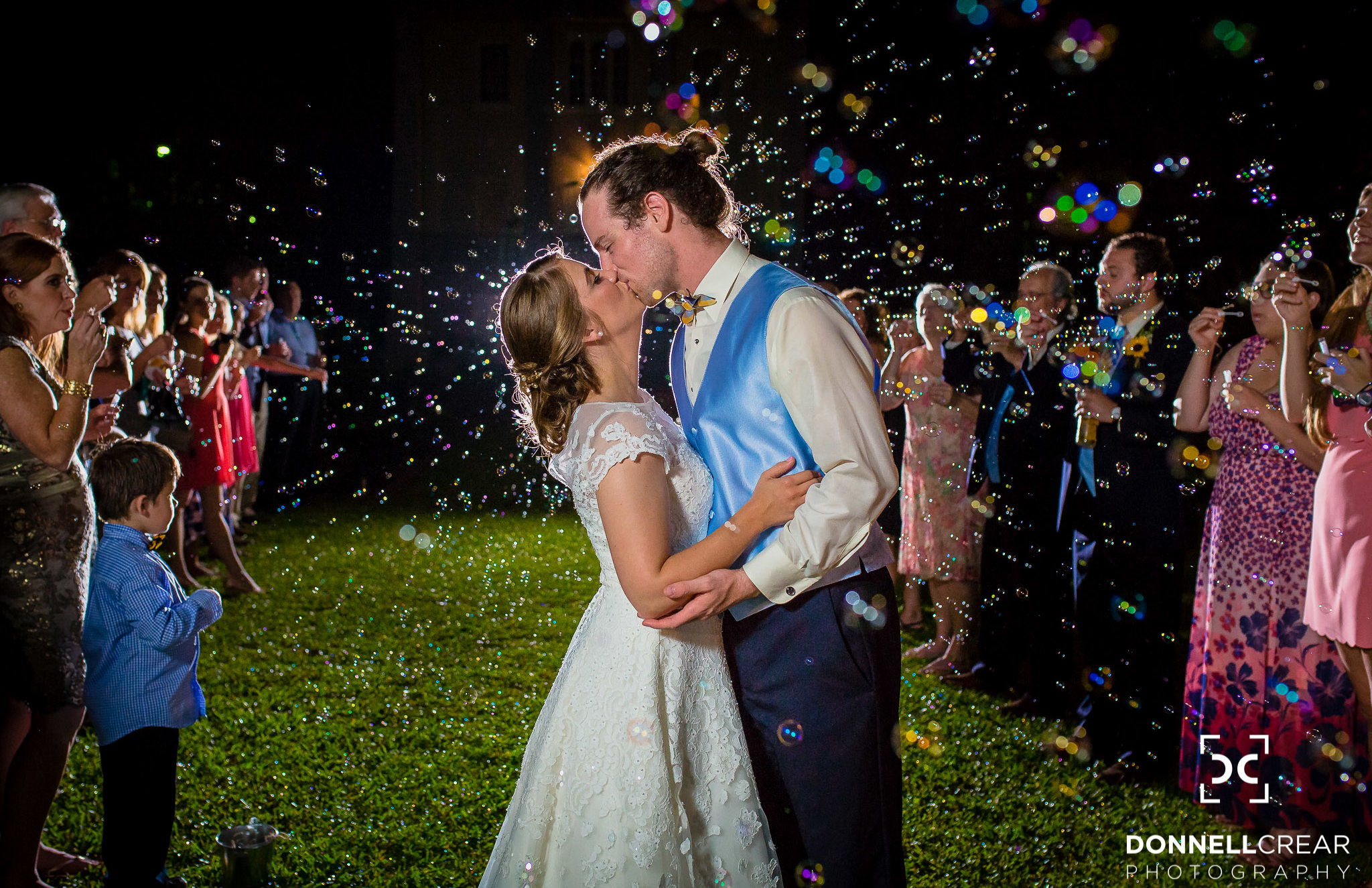 Cokesbury College wedding bubble exit with couple kissing