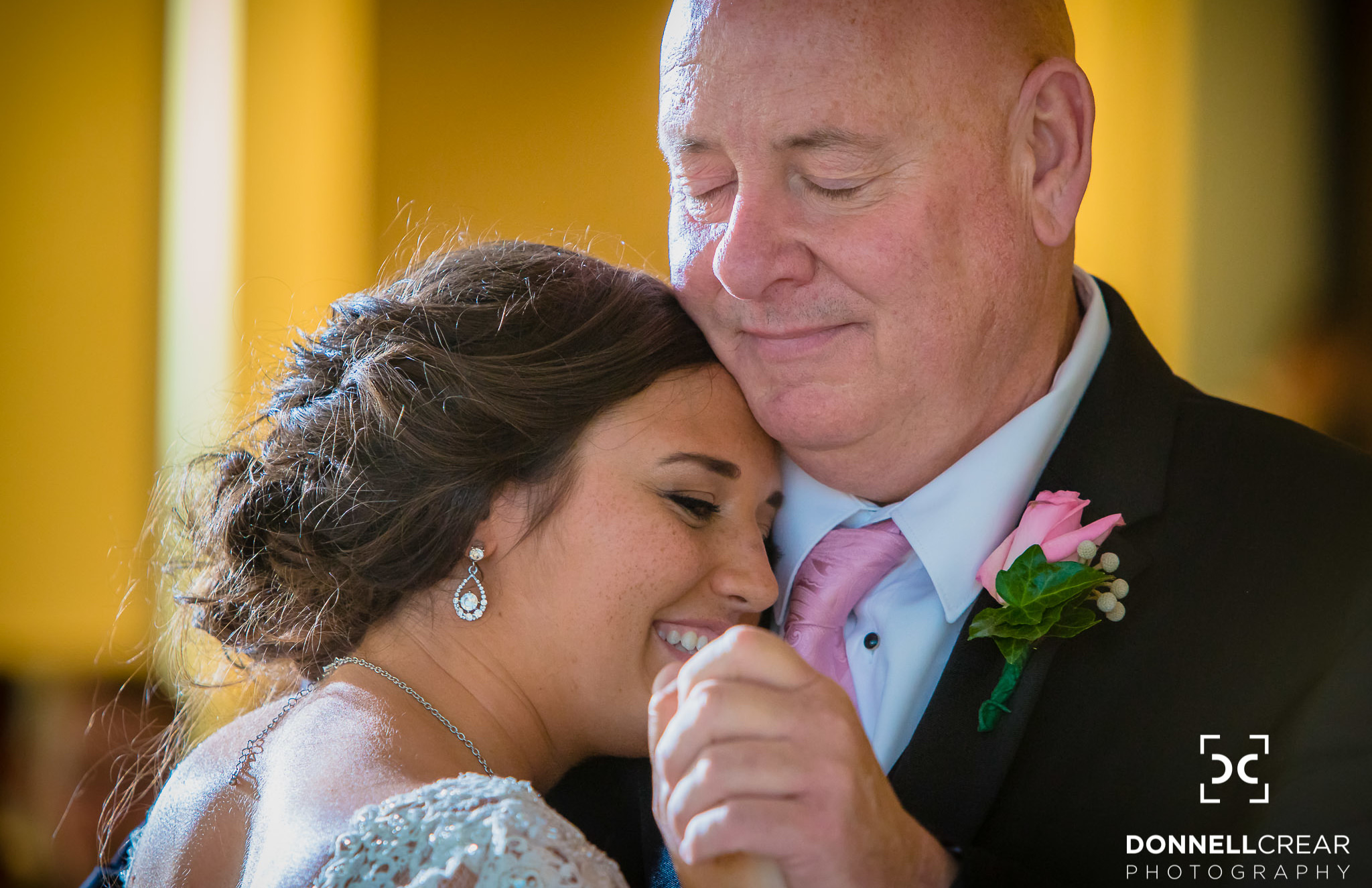 Father and daughter sharing a dance during her Commerce Club wedding
