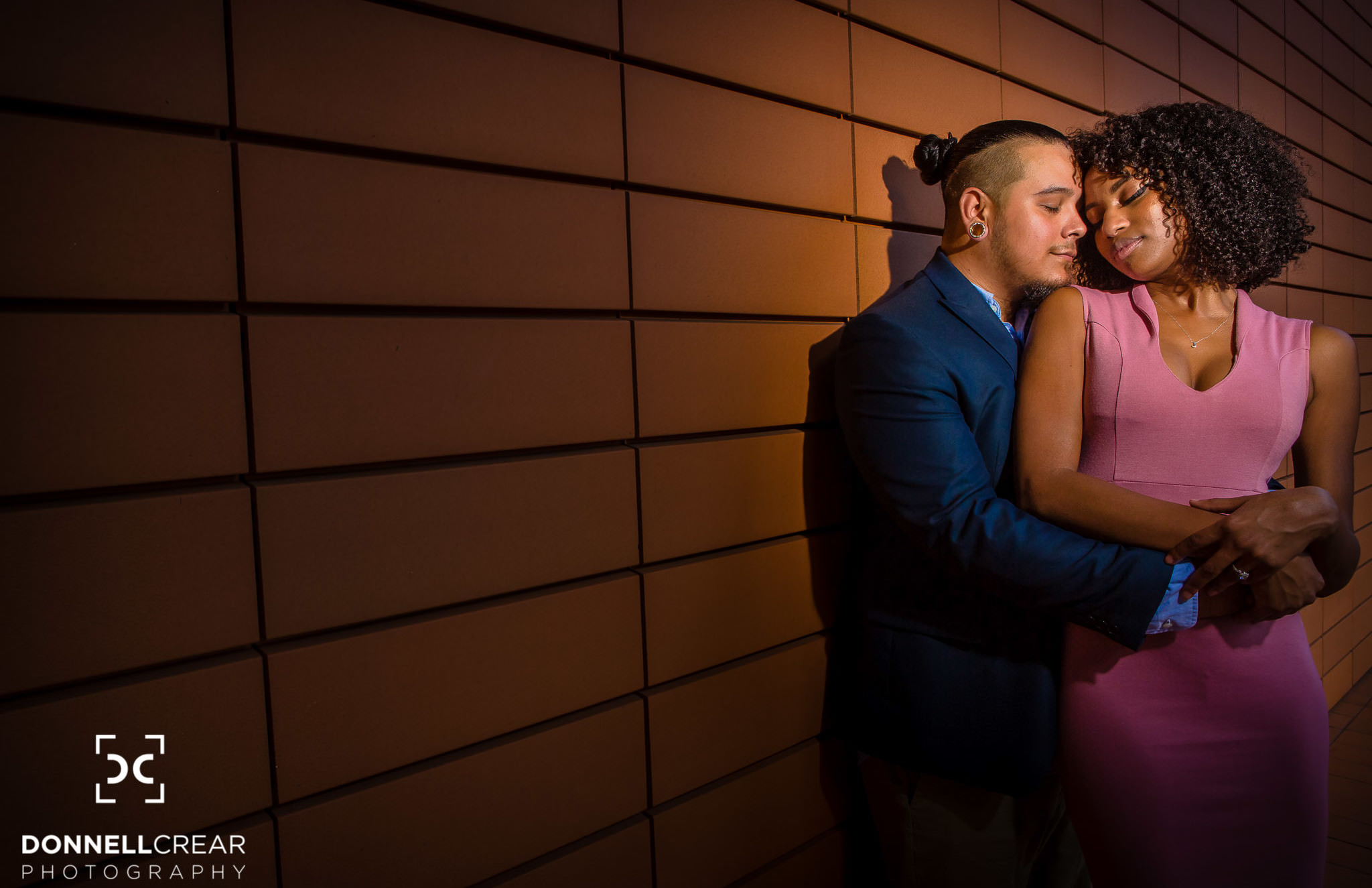 Uptown Charlotte Engagement Session in front of Bechtler Museum of Modern Art