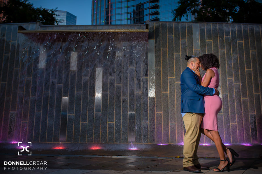 Uptown Charlotte Engagement Session in front of water wall at Romare Bearden Park