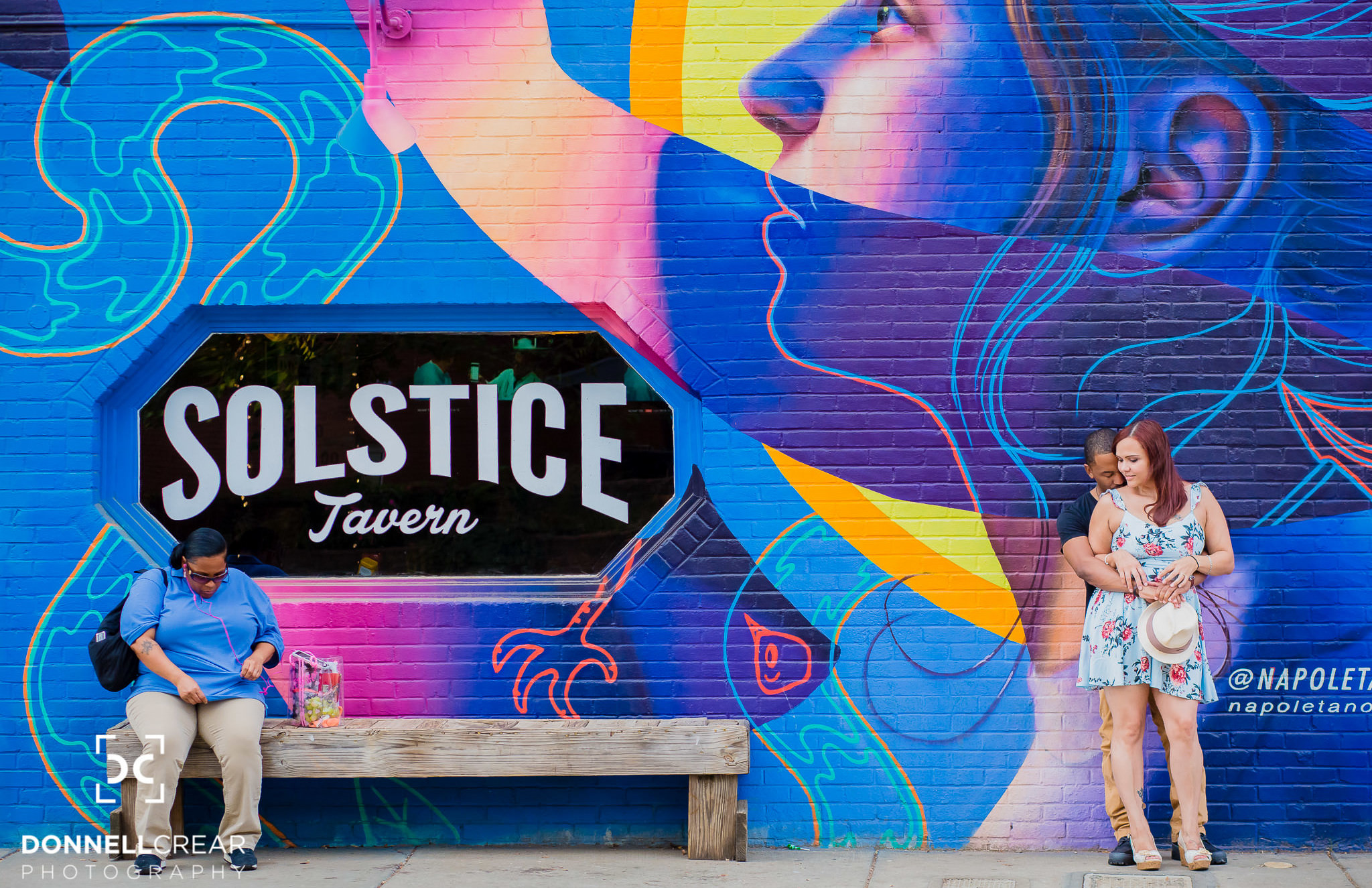 NODA Charlotte engagement session with interracial couple in front of Solstice Tavern