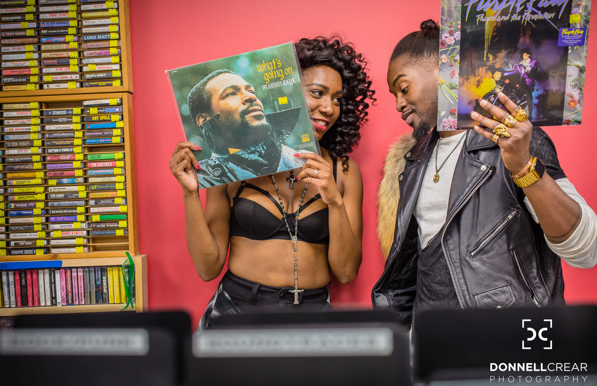 Plaza Midwood Charlotte engagement session with African American couple holding records at Lunchbox Records