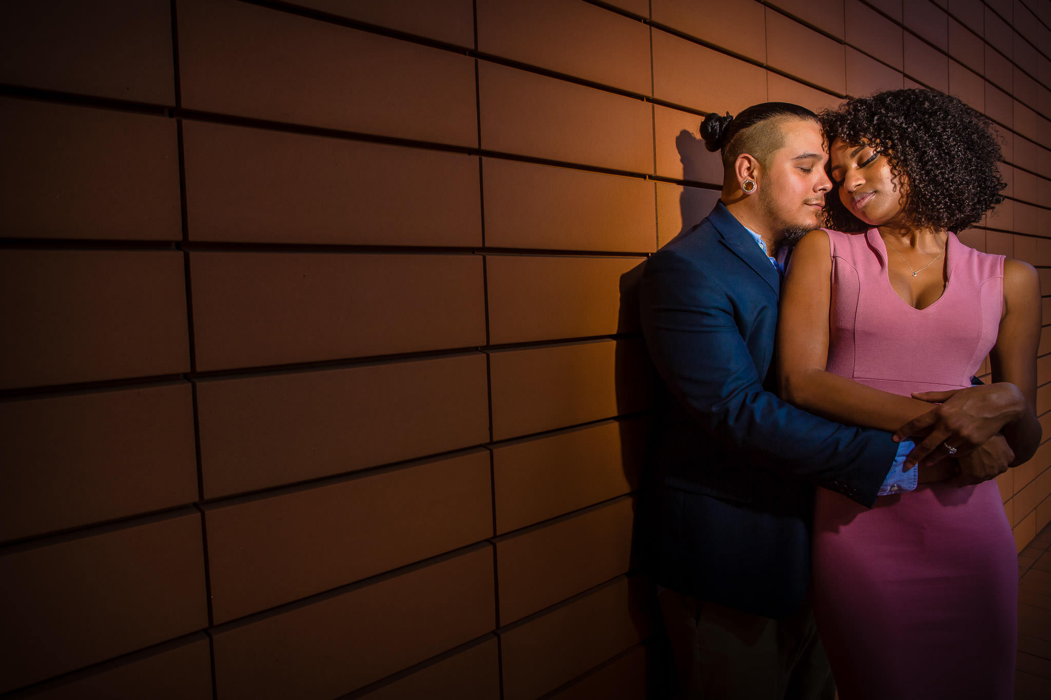 One of the best wedding photographers in Greenville SC photo from an uptown Charlotte Engagement Session in front of Bechtler Museum of Modern Art