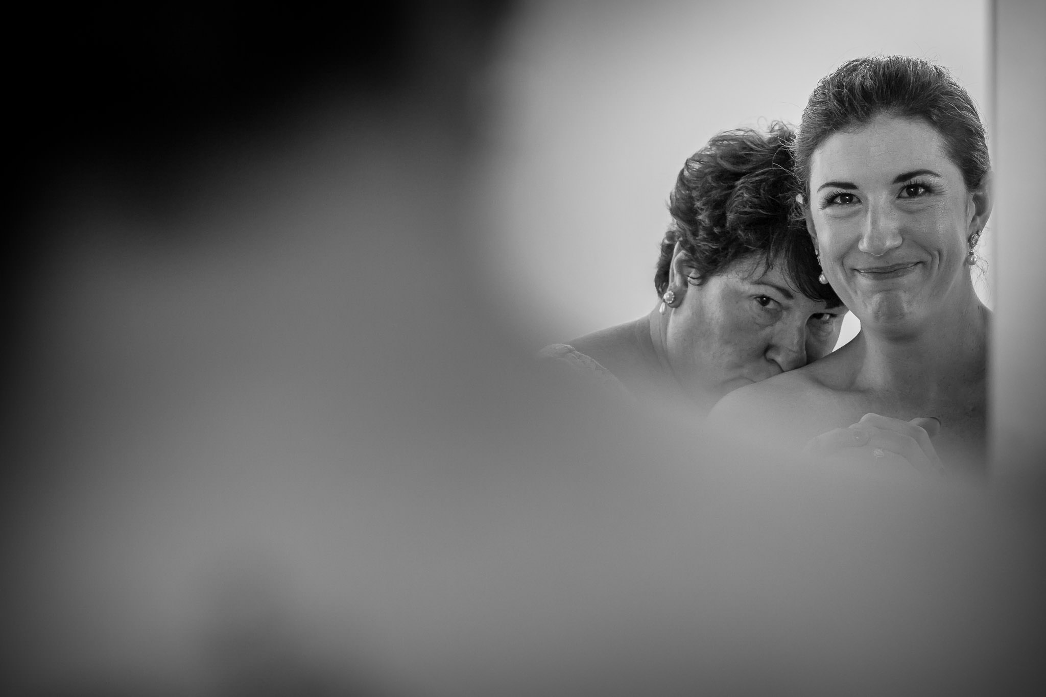 One of the best wedding photographers in Greenville SC photo of mother embracing her daughter before her twisted laurel wedding
